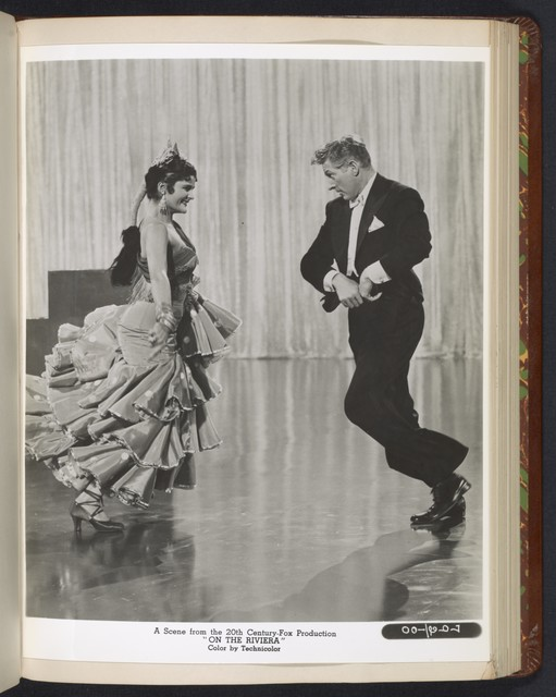"[ Danny Kaye in theatrical impersonation of the character Henri Duran, with flamenco dancer - scene from ""On the Riviera""]"