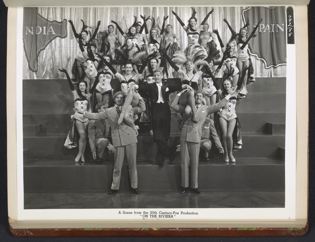 "[ Danny Kaye in theatrical impersonation of the character Henri Duran, with theatre cast - scene from ""On the Riviera""]"
