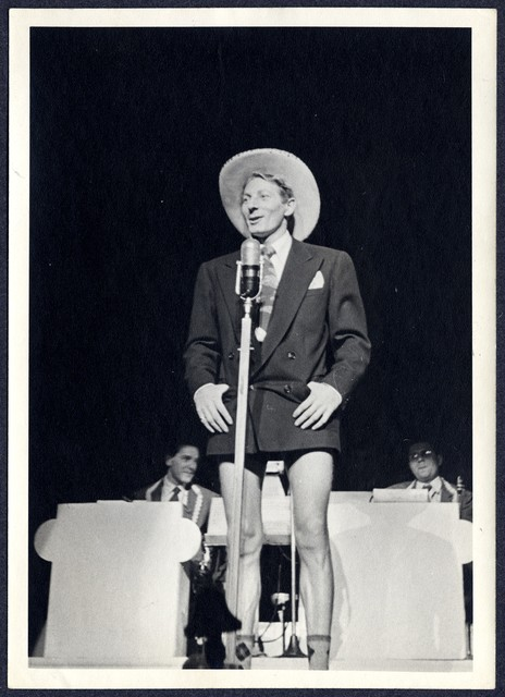 [ Danny Kaye onstage at the Roxy Theatre wearing a large cowboy hat]