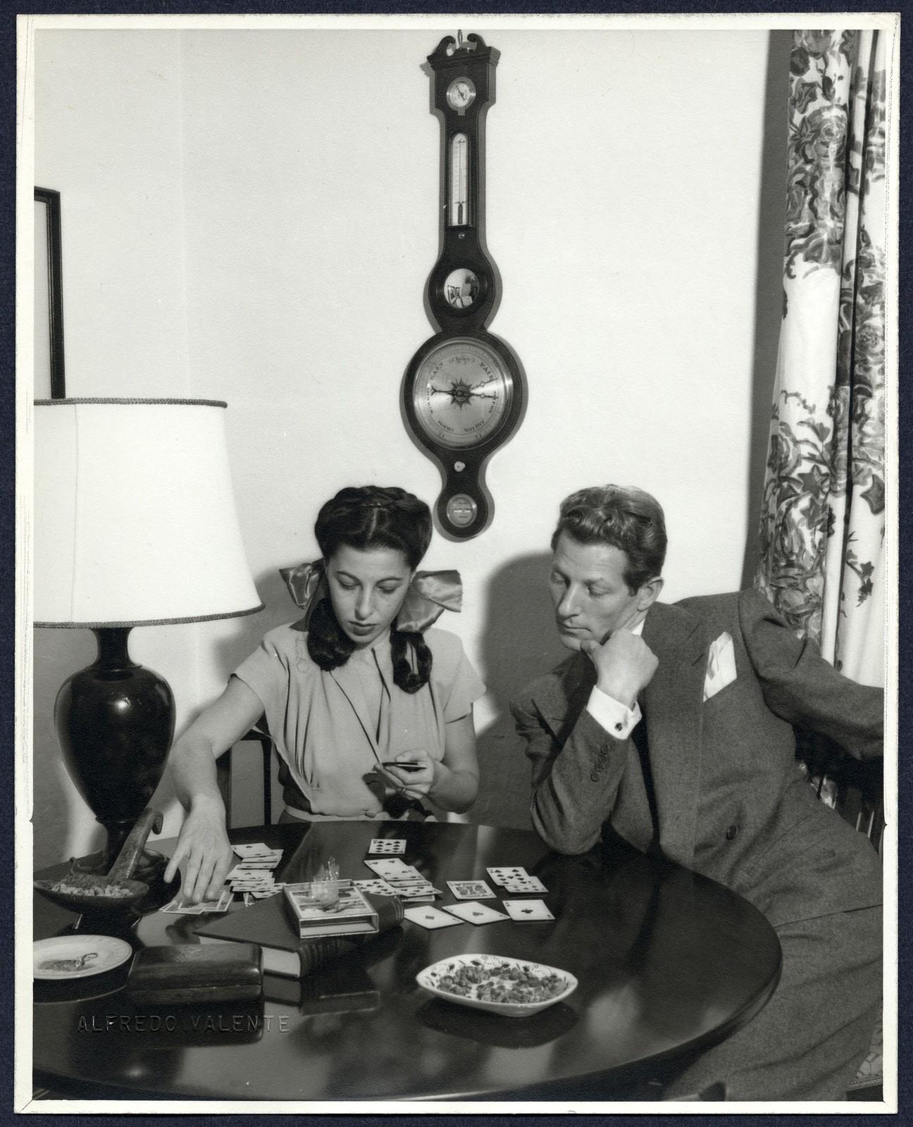 [ Danny Kaye watches Sylvia Fine play solitare at home]