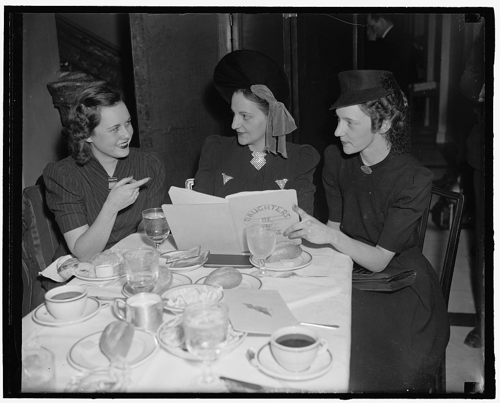 Daughters of House members now have own club. Washington, D.C., March 13. Not to be outdone by the Senate daughters who formed their club some years ago, the daughters of members of the House have now organized a social and luncheon club and meet regularly at the Capitol. Seen at today's luncheon are, left to right: Miss Martha Pace, daughter of Rep. Stephen Pace of Georgia; Miss Marjorie Griswold, daughter of Rep. Harry W. Griswold of Wisconsin; and Mrs. Katherine Craig, neice of former Rep. Craig of Okl., 3-13-40