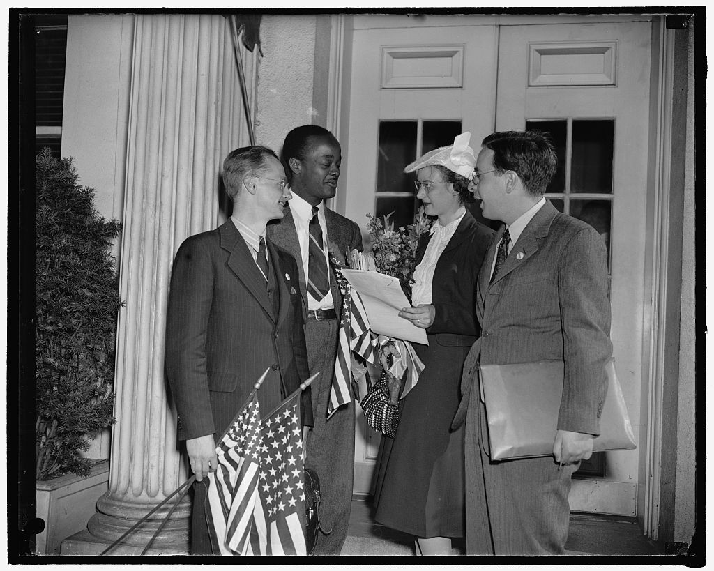 Delegates of N.Y. Youth Congress present petition at White House opposing compulsory conscription. Washington, D.C., June 20. A delegation from the New York Youth Congress called at the White House today with a petition opposing President Roosevelt's proposed plan to regiment the young men and women of American in compulsory military training and forced labor. The delegation shown on the steps of the White House are, left to right - Wesley Nelson, Church of the Master; Tom Jones, Brooklyn Negro Youth Federation; Jean Horie, Executive Secretary of the New York Youth Congress; and David Livingstone, United Wholesale and Warehouse Employees Union, N.Y. Local 65