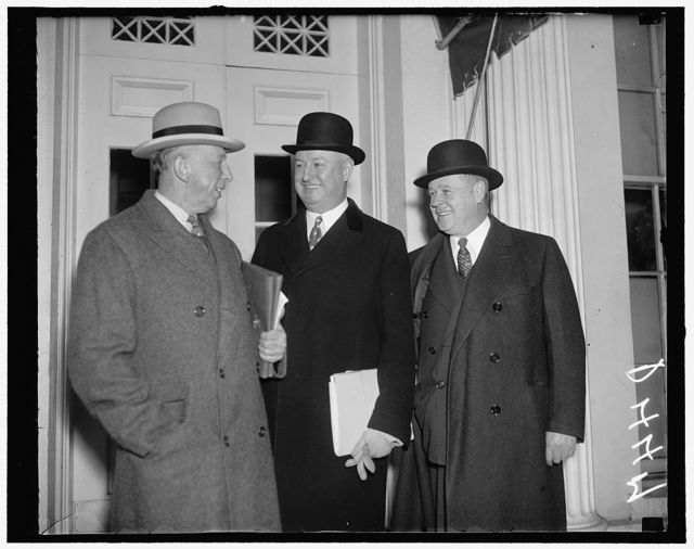 """Democrats will eat """"wictory dinner"""" March 4. Washington, D.C., Dec. 30. After reviewing Democratic party affairs with President Roosevelt today, Pmg. James A. Farley told newsmen that March 4 has been set for a Democratic """"victory dinner"""" in Washington. Farley is shown with Forbes Morgan, (left) and Frank C. walker, National Committee Executives who were also in on the conference"""
