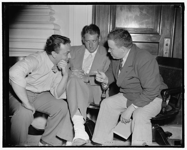 "Dies Committee told of methods to recruit youth for service with loyalists. Washington, D.C., Aug. 18. Methods used to recruit youths for service with loyalists in Spain were detailed to the Dies Committee today by Alvin I. Alpern, (left) Boston Youth, and Abraham Sobol, (center) both the youths, who are shown with Edward F. Sullivan, ace investigator for the committee, said the were recruited by the Communist Party, given funds and sent to Spain to ""take a crack at Hitler,"" 8/18/38"