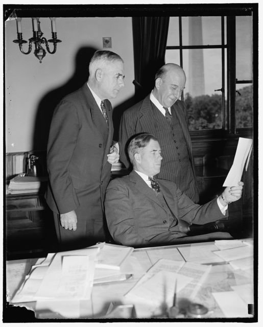 Direct nation's farm policies. Washington, D.C., Sept. 22. The farmers of the Nation look to these men to solve their many problems. Pictured, left to right, are: M.L. Wilson, Undersecretary of Agriculture; Secretary of Agriculture Henry A. Wallace, and H.R. Tolley, A.A.A. Administrator, 9/22/38