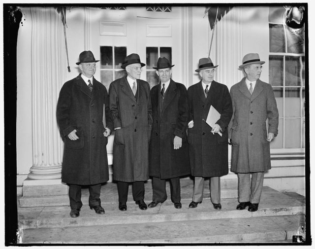 Discuss naval expansion with president. Washington, D.C., Jan. 5. High Naval Officials and members of key Congressional Committees conferred with President Roosevelt today in regard to a Naval Expansion Program. Following the meeting, Chairman Taylor of the House Appropriations Committee announced that the President will shortly send a message to Congress recommending Naval expansion. Left to right: Rep. Carl Vinson, Chairman of the House Naval Affairs Committee; Rep. Edward T. Taylor, Chairman of House Appropriations Committee; Rep. William B. Umstead of North Carolina; Assistant Secretary of the Navy Charles Edison; and Admiral William D. Leahy, Chief of Naval Operations, 1/5/38