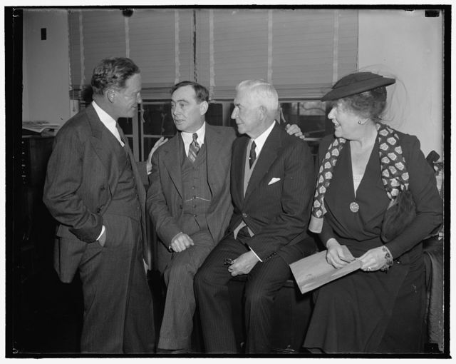 Discuss Repubican Party problems. Washington, D.C., Dec. 7. Snapped in a huddle just before the meeting of the Executive Committee of the Republican National Committee convened today were, left to right: John Hamilton, Chairman of the Republican National Committee; Rep. Joseph W. Martin Jr., House Republican Leader; Henry P. Fletcher, General Counsel; and Mrs. Paul Fitzsimons, member of the Executive Committee from Rhode Island. Presidential campaign problems and an embarrassing deficit were discussed at the meeting