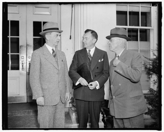 Discuss sale of helium to Germany. Washington, D.C., May 11. Germany's request to buy a large quantity of helium for German- owned commercial airships was discussed by President Roosevelt and the U.S. Chief of Staff, Chief of Naval Operations, U.S. Solicitor General, and the Secretary of Interior. Shown leaving the conference are, left to right: Admiral William D. Leahy, chief of Naval operations; Solicitor General Robert H. Jackson, and Maj. Gen. Malin Craig, chief of staff