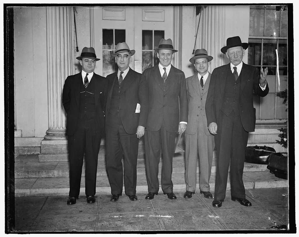 Discuss tax revision with president. Washington, D.C., Nov. 9. President Roosevelt today called a special meeting of the Government's tax experts at the White House. Leaving the meeting Rep. Robert L. Doughton, Chairman of the House Ways and Means Committee, told reporters that tax revision and proposed farm levies were discussed with the President. Left to right: Daniel Bell, Director of the Budget; Rep. Fred Vinson of Kentucky, Chairman of the House Ways and Means Committee now studying tax revision; Secretary of the Treasury Morgenthau; Roswell Magill, Undersecretary of the Treasury; and Rep. Robert L. Doughton.
