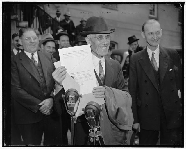 Dr. Townsend happy over pardon. Washington, D.C., April 18. Shortly before he was to be transported from the U.S. Marshall's office to the D.C., jail today to serve a 30-day sentence, Dr. Francis E. Townsend, old-age pension planner, was notified of his pardon by President Roosevelt. He is pictured displaying the pardon to newsmen and passerby at the courthouse, 4/18/38