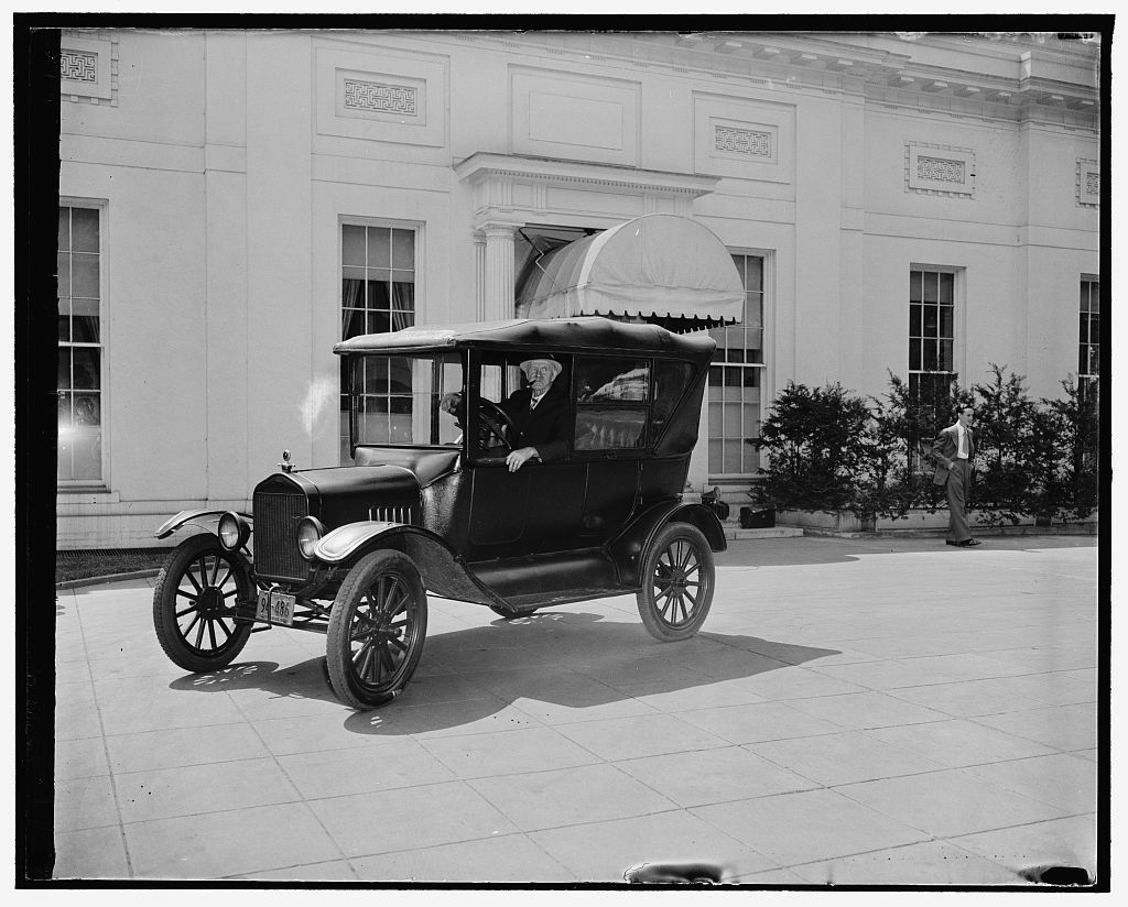 "Drives ancient ""Lizzie"" to White House to show Henry Ford. Washington, D.C., April 27. His 1921 Model T Ford polished to a mirror like finish, Ernest A. Franke, elderly Washingtonian, drove to the White House executive offices to day with intentions of showing the ancient model to Henry Ford. ""Where's Henry"" shouted Franke, from the driver's seat, ""I want to show him his old car"". Police declines to allow Franke to await the arrival of Ford who was due to have lunch with President Roosevelt, 4/27/38"