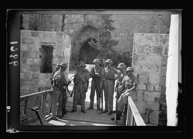 "Entrance to Citadel, Tower of David, showing troops with steel helmets occupying the ""stronghold"" against rebels in town"