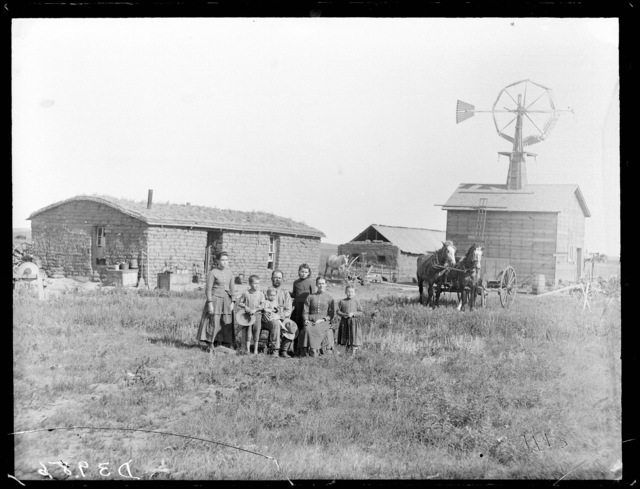 Family in front of a sod house in northwestern Custer County, Nebraska.