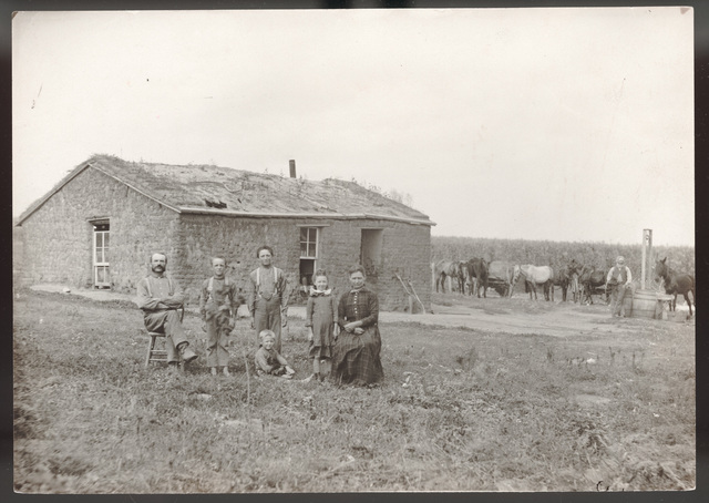 Family with their sod house in northeast Custer County, Nebraska.