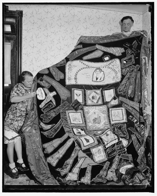 Famous historical quilt. Washington, D.C., Aug. 17. Joseph's coat of many colors had nothing on this unique quilt which is now being completed by Mrs. Ethel Sampson of Evanston, Ill., after six years of collecting. Parts of wearing apparel from President Roosevelt, Mrs. Roosevelt, members of the Cabinet, diplomats and notables from all over. From Hollywood Bing Crosby sent a tie while Mae West and Shirley Temple contributed parts of dresses. Former Emperor Haile Selassie's neckties and a linen of Winsor, are also included on the quilt. Diapers from the Dionne Quintuplets are also prominently displayed, 8/17/37