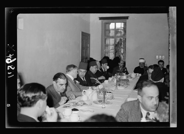 Farewell tea for Riji Bek, Egyptian Consul at the YMCA on Jan. 18, '41. Gen[eral view of long tables with guests, closer, Khaldi the Mayor, Keith Roach, Egyptian Cons[ul] Gen[eral] & Riji Bek, etc.