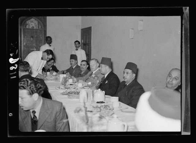 Farewell tea for Riji Bek, Egyptian Consul at the YMCA on Jan. 18, '41. Gen[eral] view of long tables with guests, closer from other end of table