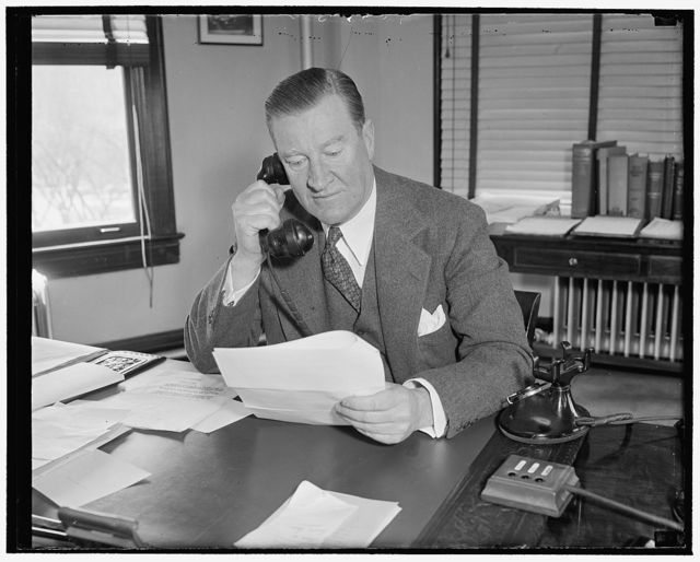Federal Housing Administrator. Washington, D.C., March 9. The Federal Housing Administrator Stewart MacDonald, photographed at his desk today, 3/9/38