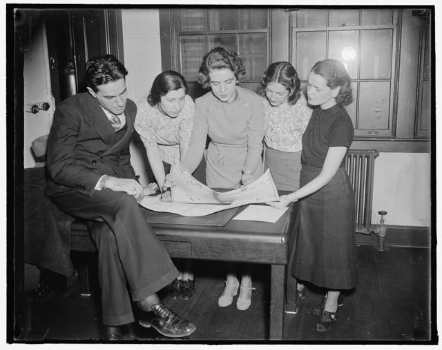 Federal workers school. Public relations and trade unions. This course taught by Miss Jessica Buck, will familiarize the student with all forms of trade union publicity, including newspaper, radio, union publications and leaflets. Miss Buck (center) is explaining newspaper make-up to the students in this photograph. 11/30/37