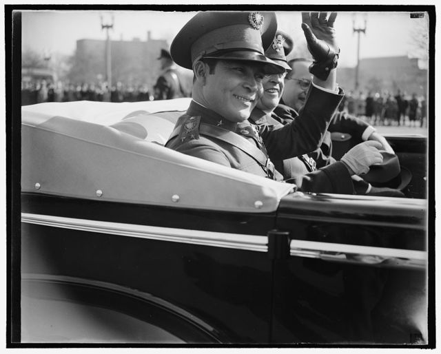 Former Cuban Army Sergeant visits Capitol. Washington, D.C., Nov. 10. Colonel Fulgencio Batista, the Cuban Army Sergeant who is now the boss of the Island of Cuba. Shown as he waved to the crowds that welcomed him to the Nations Capitol, for his first visit outside the Island in thirty seven years, 10/10/38