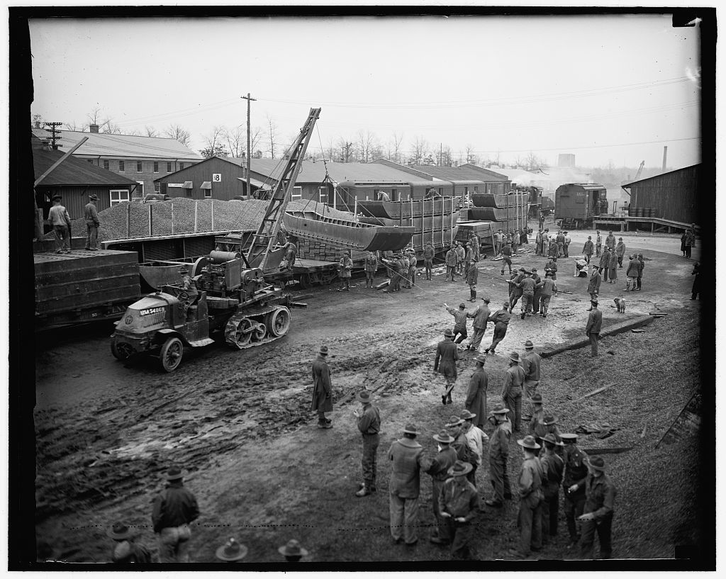 Fort Belvoir troops proceed to flood area. Fort Belvoir, Va. Company B of the 5th Regiment of Engineers, stationed at this post a short distance from the Capitol, mobilized complete campaign equipment today and prepared to entrain immediately for the devastated flood area near Louisville, Ky. in this photo one of the boats to be used is shown being put aboard the train