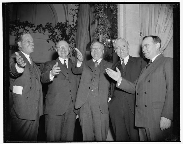 Forward to Forty!' cry of republicans at dinner tonight. Washington, D.C., April 20. Full of high hopes and confidence as they look toward 1940, members of the republican party got together tonight for a dinner at which they forecast victory for themselves at the coming presidential elections. Here are some of the outstanding Republicans giving a salute to 1940. Left to right: Republican National Committee Chairman John Hamilton, Senator Robert Taft, Ohio's newest hope for the presidency, Gov. Raymond Baldwin of Connecticut, Senator Clyde M. Reed of Kansas, which state saw one presidential hope die in the last election, and Rep. Joseph W. Martin Jr., House Minority Leader