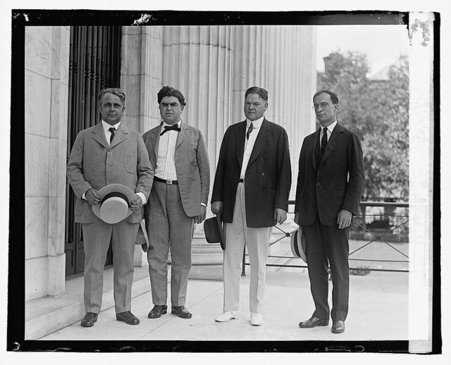 [Four men standing outside building], 7/2/22