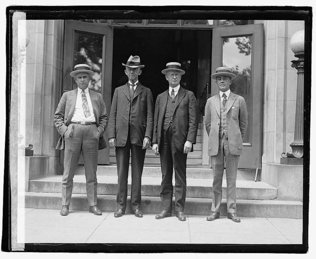 [Four unidentified men outside building], 5/31/22