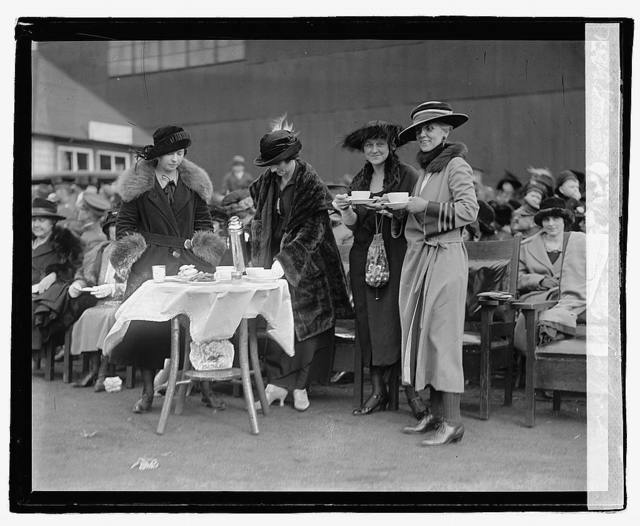 [Four unidentified women standing with refreshments with audience in background], 10/25/22