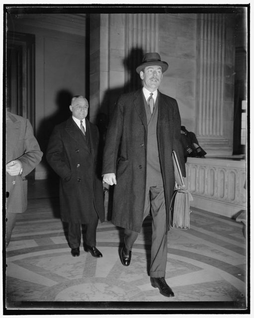 Frankfurter and counsel. Washington, D.C., Jan. 13. Dean Acheson, counsel for Felix Frankfurter, Supreme Court Nominee, pictured with his client leaving the Capitol after the Harvard professor was questioned by the Senate Commerce Committee, 1/13/39