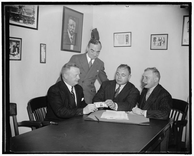 Galento puts up 10-grand note as challenge to Joe Louis. Washington, D.C., Nov. 9. Roly Poly Tony Galenton today deposited with the D.C. Boxing Commission ten thousand dollars as a challenge to Joe Louis for a championship bout. Tony claims Joe Louis ran out on him when he accepted a bout with John Henry Lewis instead. Left to right - sitting- Secretary Harvey L. Miller of the D.C., Boxing Commission - Tony Galento, Joe Jacobs, his manager. Standing is Herman Taylor, Philadelphia promoter whose schedules bout between Galento and Louis was postponed because of Tony's illness, 11/9/38