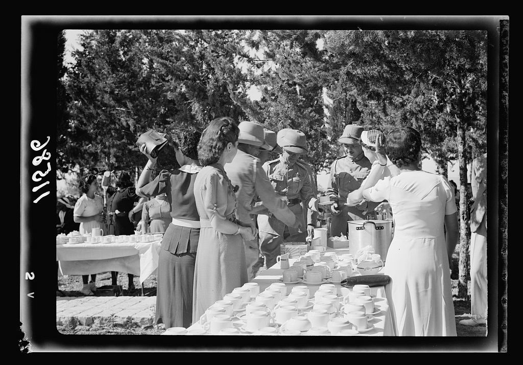 Galilee trip. Nazareth, afternoon fete in aid of the Red Cross & Knights of St. John. Nazareth ladies & ladies of government officials serving tea [to] Army men