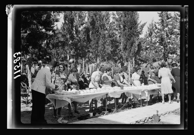 Galilee trip. Nazareth, afternoon fete in aid of the Red Cross & Knights of St. John. Nazareth ladies & ladies of government officials serving tea