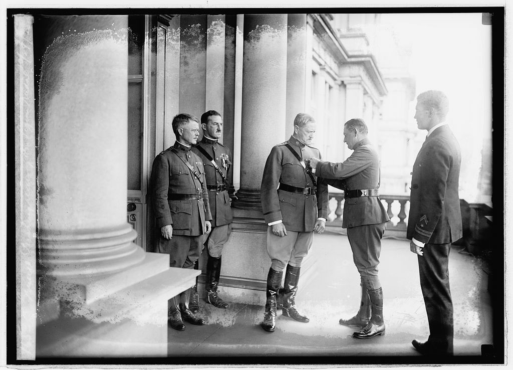 General Pershing receiving Am. Legion Medal, 10/29/21