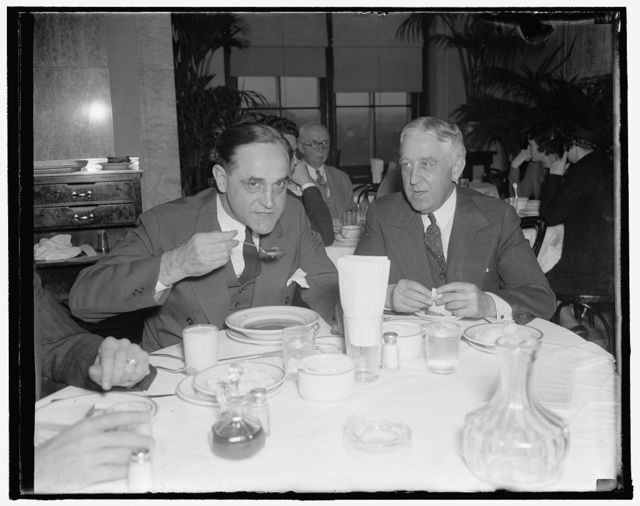 Gentlemen from Indiana. Washington, D.C., Nov. 15. Democratic Senator Sherman Minton of Indiana, takes time out at the opening of the special session to enjoy a bit of lunch in the Capitol restaurant. 11/15/37