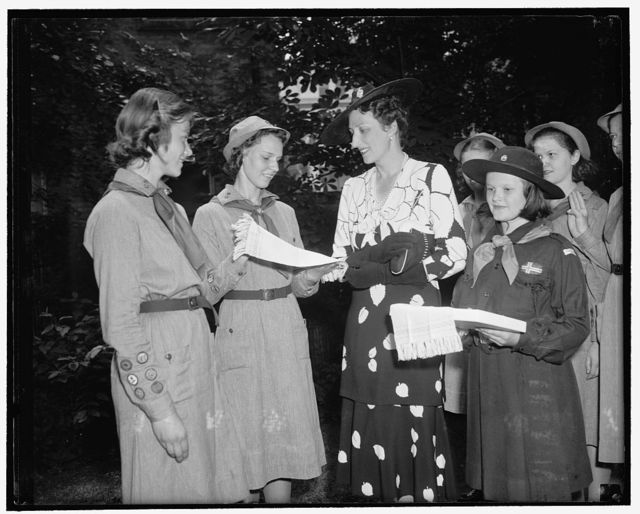 Girl Scouts present guest towels to Princess Martha of Norway. Washington, D.C., June 30. While visiting the National Girl Scouts Little House today, Princess Martha of Norway was presented with a pair of hand woven guest towels by Dorothy Kramer of troop 22, who did the weaving of them. In the picture can be seen, left to right: Grete Galbe, Dorothy Kramer, Princess Martha, and Kari Galbe. The Galbe girls are the daughters of the Counselor of the Norwegian Legation and Madame Galbe