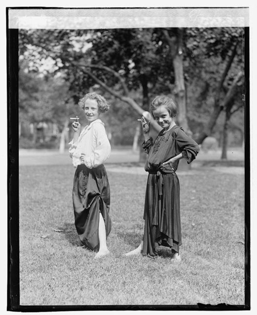 [Girls dressed as adults, posing with cigarettes], 8/31/23