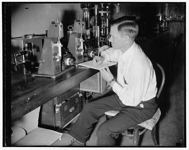 Government discovers method to preseve film. Folding endurance test, The flexibility is measured in this folding endurance tester. A strip of film is folded back and forth under tension until it breaks, and the number of folds it withstands is counted. Three types of films have been studied, termed accoring to the chemical process of making them, acetate, viscose, and nitrate. The acetate base proved to be very stable on heating and is considered suitable for permanent records if properly made. The nitrate base became brittle quite raipidly and is considered unsuited for record purposes. The viscose base is in an intermediate position similar to that of record papers made from ordinary bleach wood fiber, 7/8/38