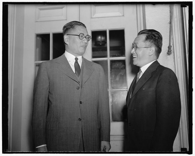 Governor of Bank of China presented to President Roosevelt. Washington, D.C., July 1. Dr. T.V. Soong, left, Governor of the Bank of China, was presented to President Roosevelt today by Dr. Hu Shih, Chinese ambassador. Dr. Soong told reporters his visit was purely social, 7-1-40