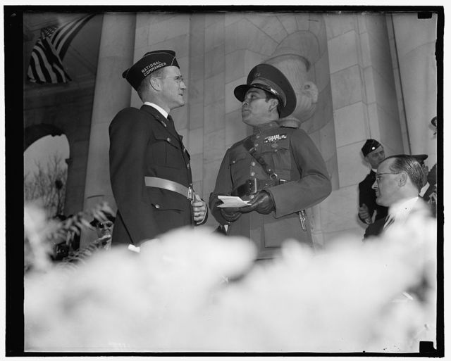 Greetings. Washington, D.C., Nov. 11. National Commander of the American Legion Stephen Chadwick, exchanges greetings with Cuba's Dictator Col. Fulgencio Batista at Armistice Day ceremonies at Arlington National Cemetery where the National paid homage to America's Unknown Soldier, 11/11/38