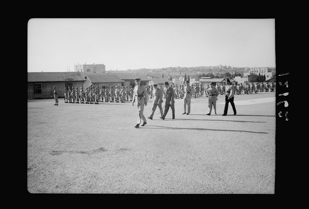 H.E. (i.e., His Excellency) the High Commissioner reviews first Jerusalem Company of the Palestine Volunteer Force. H.E. (i.e., His Excellency) & accompanying officers leaving parade ground for salute stand