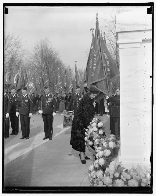 Head of Legion Auxiliary honors unknown soldier. Washington, D.C., Nov. 11. Joining the heads of many other Military Organizations, Mrs. Malcolm Douglas, National President of the American Legion Auxiliary, placed a wreath on the tomb of the Unknown Soldier in Arlington to observe Armistice Day, 11/11/37