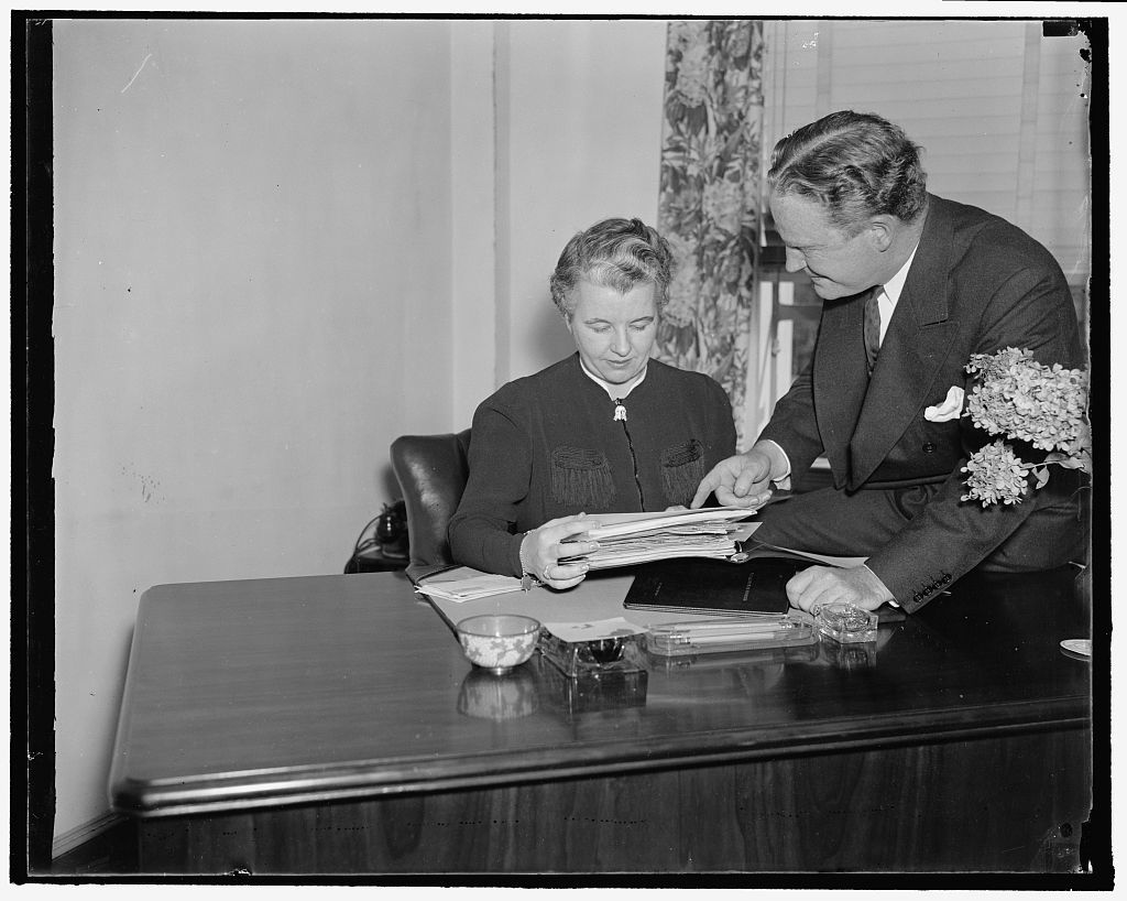 Heads of the National Republican Committee. Washington, D.C., Sept. 23. John Hamilton, Chairman of the National Republican Party, (right) confers with Miss Marion E. Martin of Bangor, ME. Who has recently been appointed Assistant to the Chairman in charge of Women's Activities of the Republican National Committee. 9/23/37