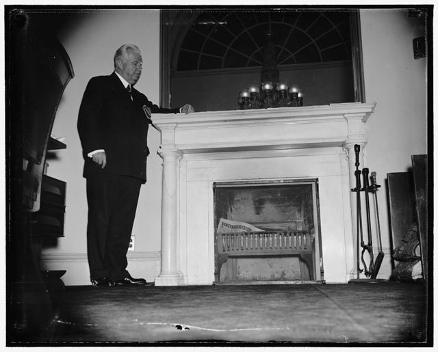 [...]historic fireplace. Washington, D.C., Sergeant of Arms of [...] Senate, Chesley W. Jurney is proud of [...] fireplace in his office at the Capitol. The office was originally used by the U.S. Supreme Court as conference room where the fireplace was installed in 1800. It is still doing duty on cool days, 3/24/38
