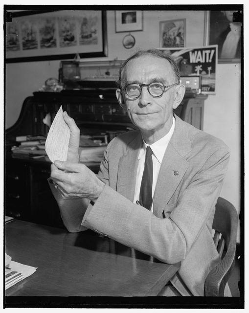 Holds first transatlantic flight reservation. Washington, D.C., June 14. W.J. Eck, assistant to the Vice President of the Southern Railway, holds here the receipt for his ticket of the first regularly scheduled flight of west-east passenger plans across the Atlantic. He will take off June 28 at New York, arrive at Marseilles the 31st with two stops at the Azores and Portugal. His round trip ticket, costing $675, will give him a total of 9,416[?] miles of flight