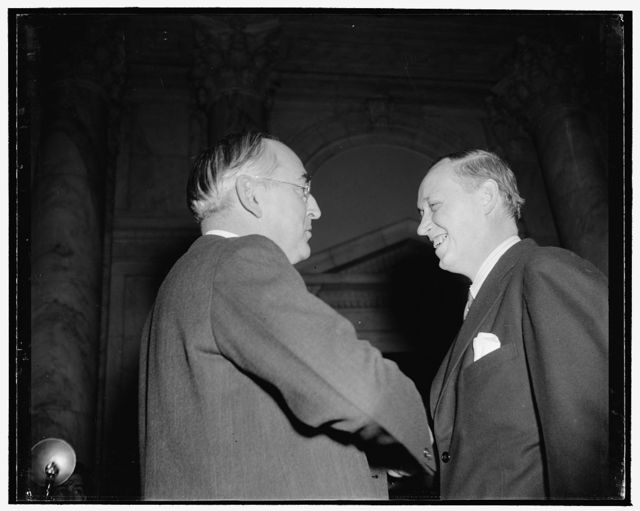 Hopkins and Chief Questioner at Senate Commerce hearing. Washington, D.C., Jan. 11. The smile on the face of Secretary of Commerce Harry Hopkins, shown talking here with Republican Senator Arthur M. Vandenberg of Michigan, soon turned to a sneer under sharp questioning by members of the Senate Commerce Committee today. With Senator Vandenberg as chief questioner at the opening session, Hopkins vigorously defended the WPA against charges that it had been used as a political organization. Asserting that he had done everything in his power to 'keep politics out of it,' 1/11/39
