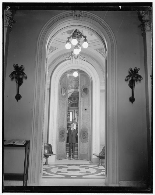 House doors ready for Congressional opening. Washington, D.C., Jan. 2. Joseph J. Sinnott, doorkeeper of the House of Representatives, makes a final inspection of the huge doors leading to the House Chamber to be sure there will be no hitch in their opening when the third session of the 76th Congress convenes tomorrow
