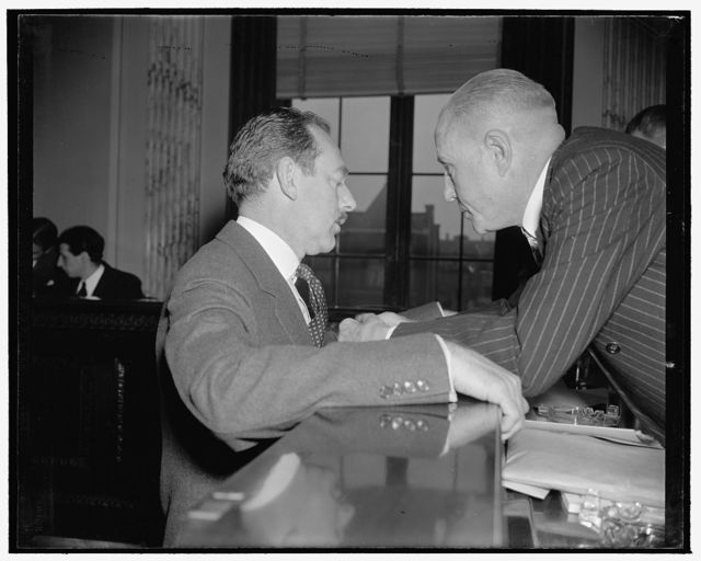 In huddle. Washington, D.C., Jan. 11. Dean Acheson, counsel for Felix Frankfurter before the Senate Judiciary Subcommittee, went into frequent huddles to [...] with Chairman M.M. Neely during the questioning of witnesses opposing the appointment of Frankfurter to the Supreme Court, 1/11/39