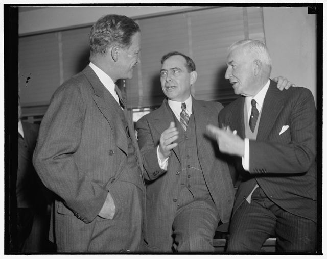 In spotlight at Republican meeting. Washington, D.C., Dec. 7. Early arrivals for today's meeting of the Executive Committee of the Republican National Committee were, left to right: John Hamilton, Chairman; Rep. Joseph W. Martin, Jr., House Republican Leader; and Henry P. Fletcher, General Counsel