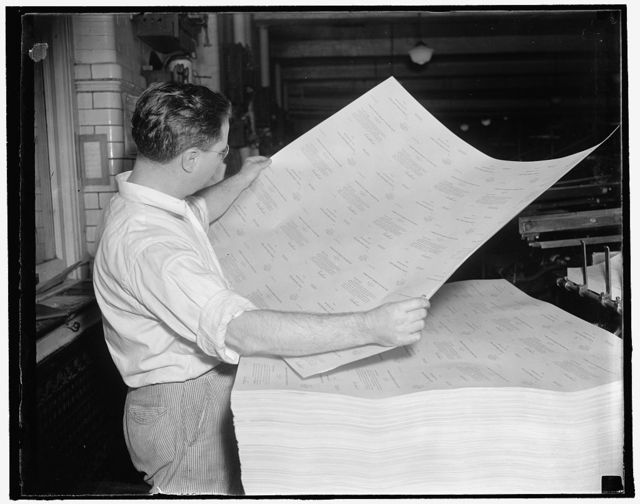 Inspects unemployment questionnaire as it comes off the press. Washington, D.C., Oct. 7. A pressman frequently inspects the sheets of unemployment census blanks as they come off the press at the Government Printing office. 3,000,000 of the questionnaires are being printed daily at Uncle Sam's big printing plant. 10/7/37
